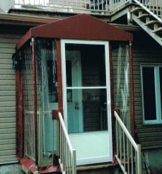 Door awning and wrap-around porch